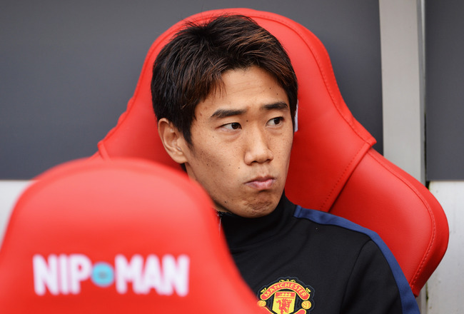 Hi-res-183158973-shinji-kagawa-of-manchester-united-looks-on-from-the_crop_650x440