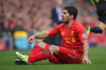 Hi-res-183158790-luis-suarez-of-liverpool-after-being-fouled-during-the_display_image