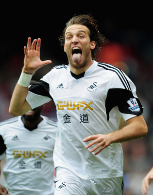 Hi-res-181532017-michu-of-swansea-city-celebtates-his-goal-during-the_display_image
