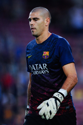 Hi-res-182585920-victor-valdes-of-fc-barcelona-looks-on-during-the-warm_display_image