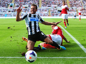 Hi-res-178919394-matthew-briggs-of-fulham-tackles-yohan-cabaye-of_display_image