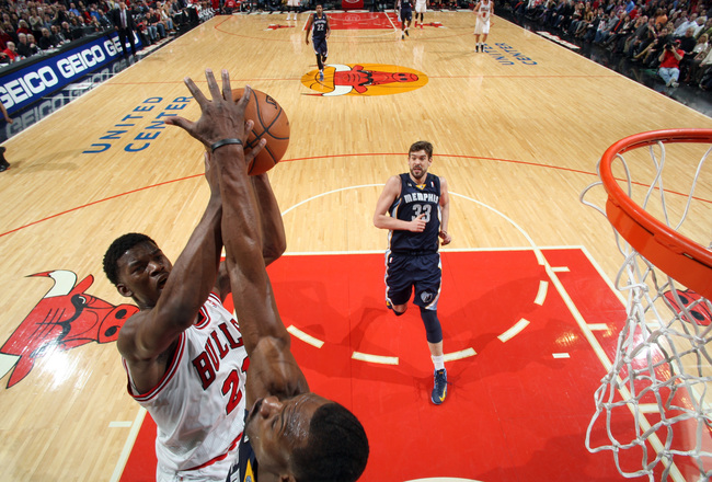 Hi-res-159744430-jimmy-butler-of-the-chicago-bulls-shoots-against-mike_crop_650x440