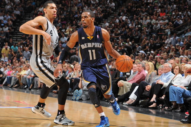 Hi-res-169239899-mike-conley-of-the-memphis-grizzlies-handles-the-ball_crop_650