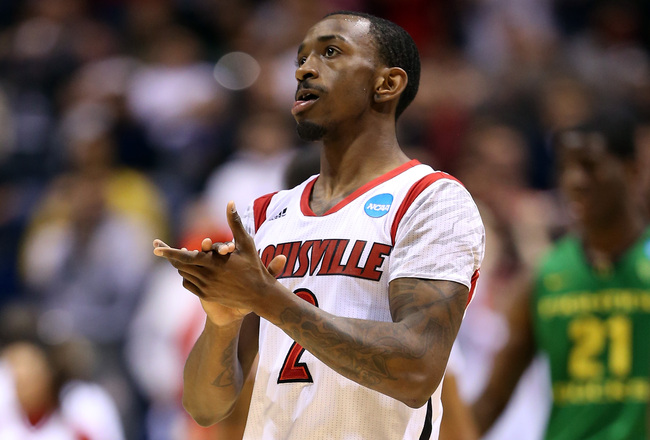 Hi-res-164966751-russ-smith-of-the-louisville-cardinals-reacts-after_crop_650x440