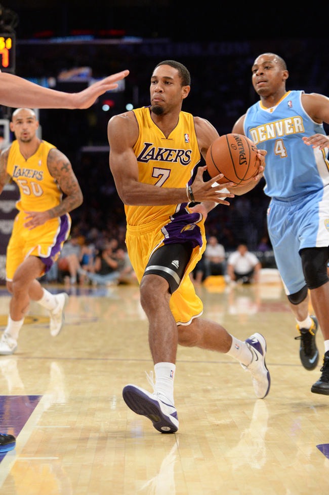 LOS ANGELES, CA - OCTOBER 6: Xavier Henry #7 of the Los Angeles Lakers drives to the basket during a game against the Denver Nuggets at STAPLES Center on October 10, 2013 at in Los Angeles, California. NOTE TO USER: User expressly acknowledges and agrees
