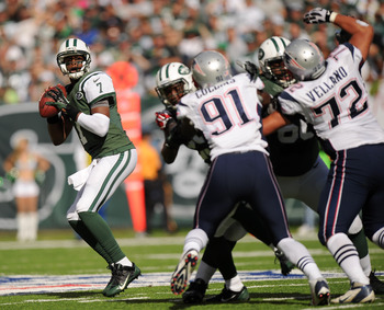 Hi-res-185420129-geno-smith-of-the-new-york-jets-looks-to-pass-during_display_image