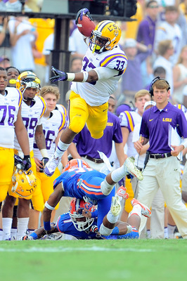 Hi-res-184237337-jeremy-hill-of-the-lsu-tigers-leaps-over-cody-riggs-of_display_image