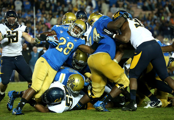 Hi-res-184265097-running-back-malcolm-jones-of-the-ucla-bruins-carries_display_image