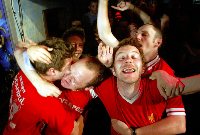 Hi-res-52980622-liverpool-fans-hug-each-other-after-midnight-as-they_crop_650x440