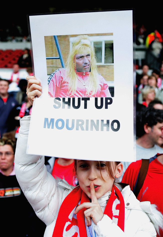 Hi-res-52753966-liverpool-fan-shows-a-sign-of-jose-mourinho-before-the_crop_650