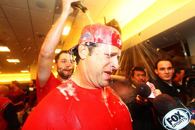 Hi-res-183849420-lance-lynn-pours-champagne-on-manager-mike-matheny-of_crop_650