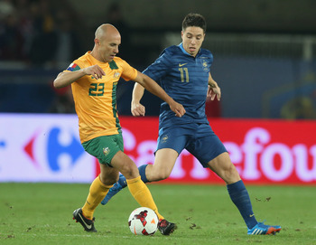 Hi-res-184082688-mark-bresciano-of-australia-moves-away-from-samir-nasri_display_image