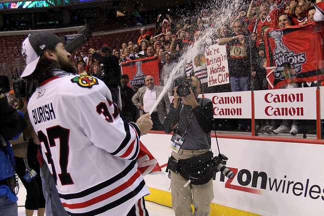 Hi-res-101936265-adam-burish-of-the-chicago-blackhawks-spays-champagne_crop_650