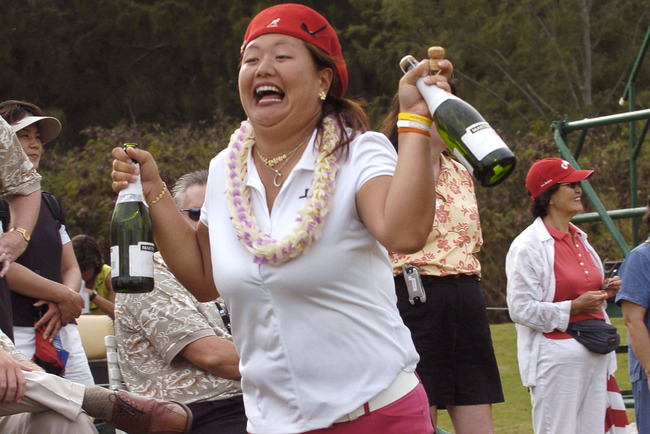 Hi-res-98149149-christina-kim-carries-two-champagne-bottles-to-a-victory_crop_650