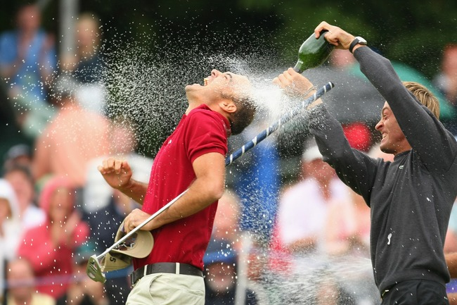 Hi-res-75422552-gregory-havret-of-france-is-drenched-with-champagne-by_crop_650