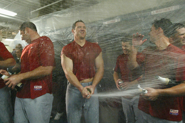 Hi-res-51461264-scott-rolen-of-the-st-louis-cardinals-sprays-teammates_crop_650