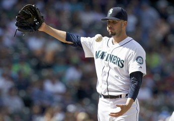 Hi-res-173806334-oliver-perez-of-the-seattle-mariners-tosses-the-ball-in_display_image