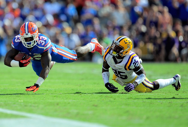Hi-res-184231468-mack-brown-of-the-florida-gators-is-tripped-up-by-kwon_crop_650x440