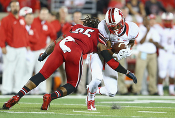 Hi-res-184005923-quron-pratt-of-the-rutgers-scarlet-knights-is-tackled_display_image
