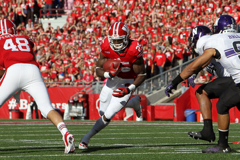 Hi-res-184230722-melvin-gordon-of-the-wisconsin-badgers-runs-for-some_display_image