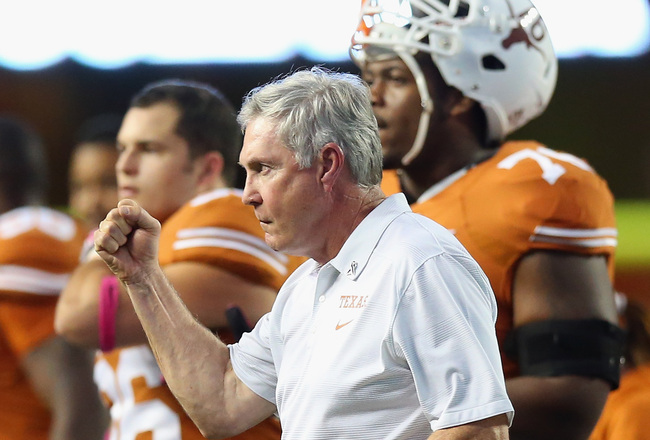 Hi-res-181493584-head-coach-mack-brown-pumps-his-fist-after-a-call-was_crop_650x440