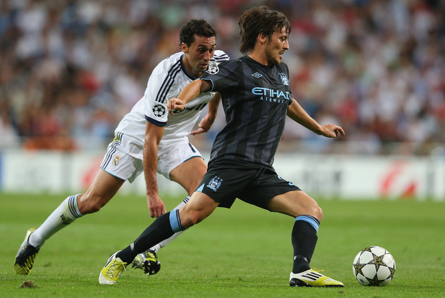 Hi-res-152321066-david-silva-of-manchester-city-fc-beats-alvaro-arbeloa_crop_650