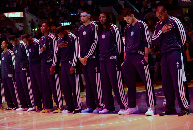 Hi-res-183484652-members-of-the-denver-nuggets-stand-in-observance_crop_650x440