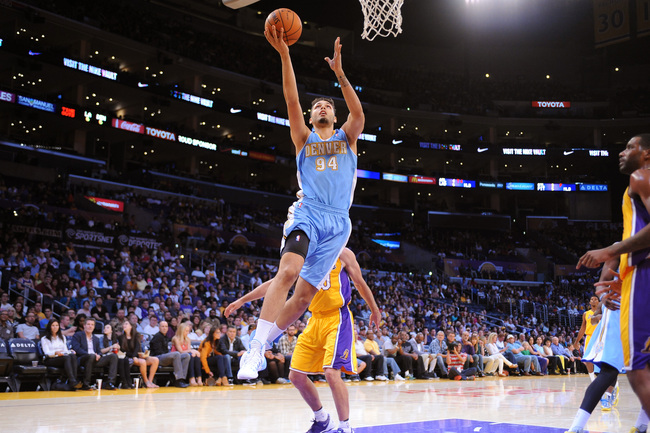 Hi-res-183484641-evan-fournier-of-the-denver-nuggets-shoots-a-layup_crop_650