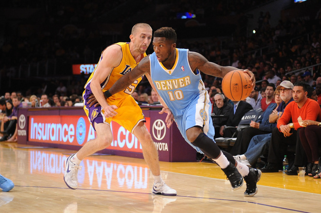 Hi-res-183488242-nate-robinson-of-the-denver-nuggets-drives-to-the_crop_650