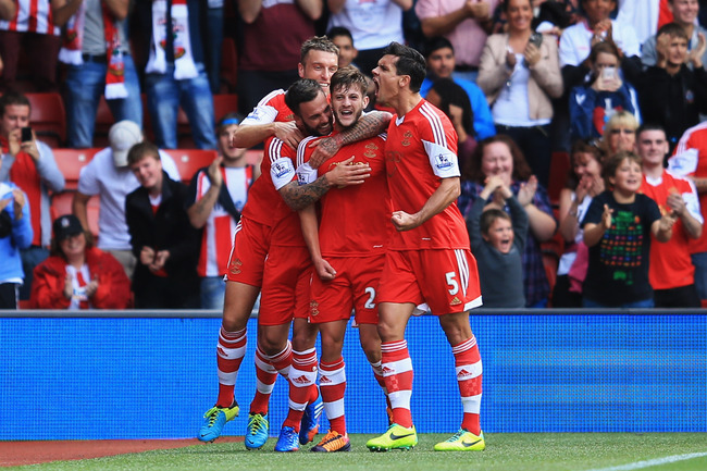 Hi-res-183394396-adam-lallana-of-southampton-celebrates-with-team-mates_crop_650