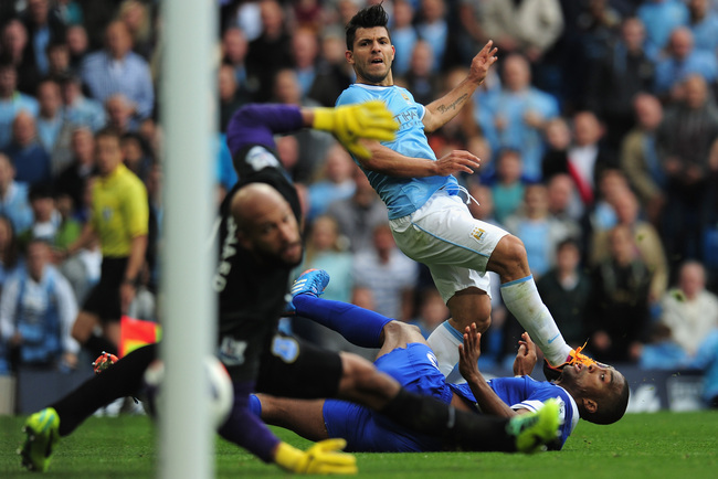 Hi-res-183153403-sergio-aguero-of-manchester-city-shoots-past-sylvain_crop_650