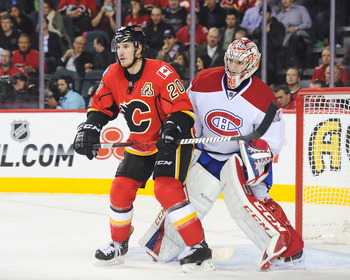 Montreal Canadiens goalie Carey Price and Calgary Flames forward Curtis Glencross.