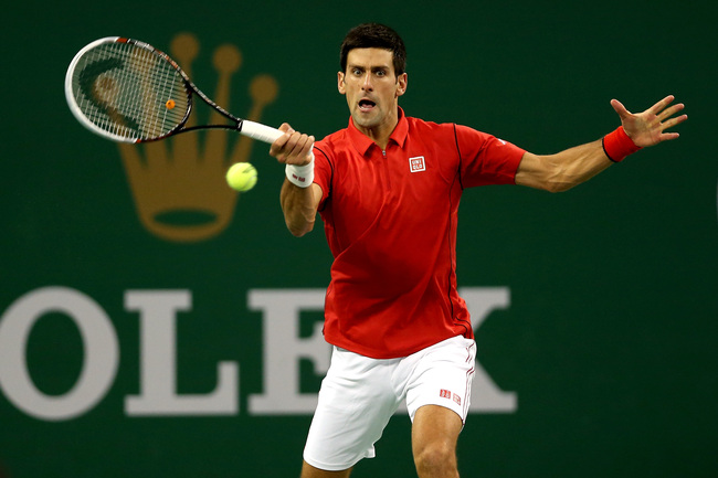 Hi-res-184211839-novak-djokovic-of-serbia-returns-a-shot-to-jo-wilfired_crop_650