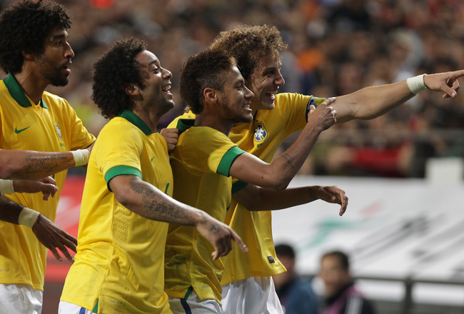 Hi-res-184211768-neymar-of-brazil-celebrates-with-team-mates-after_crop_650x440