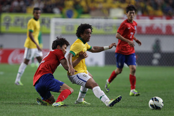 Hi-res-184214065-marcelo-of-brazil-competes-for-the-ball-with-han-kook_display_image