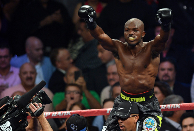 Hi-res-184265085-welterweight-champion-timothy-bradley-jr-celebrates-his_crop_650x440