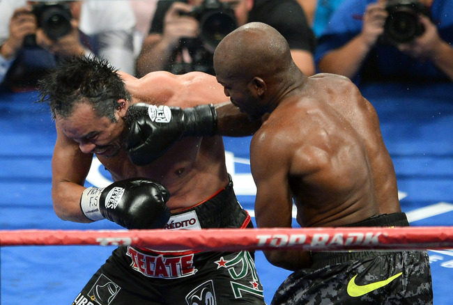 Hi-res-184261687-welterweight-champion-timothy-bradley-jr-hits-juan_crop_650