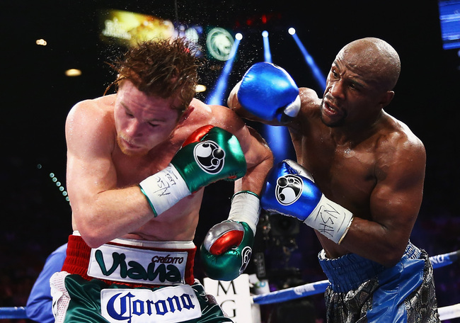 Hi-res-181785651-floyd-mayweather-jr-throws-a-right-to-canelo-alvarez_crop_650