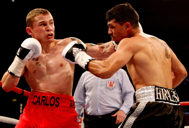 Hi-res-145336775-carl-frampton-in-action-with-raul-hirales-during-their_crop_650x440