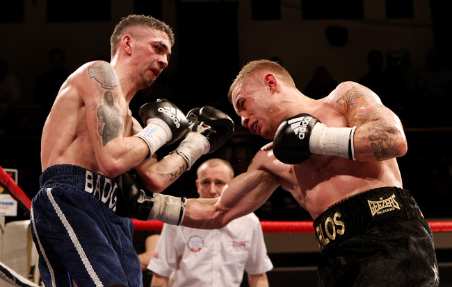 Hi-res-137903593-carl-frampton-in-action-with-kris-hughes-during-the_crop_650