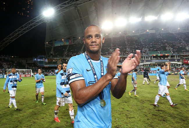 Hi-res-174541917-vincent-kompany-of-manchester-city-celebrates-after_crop_650x440