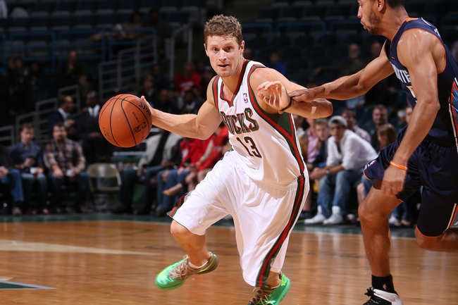 Hi-res-184245432-luke-ridnour-of-the-milwaukee-bucks-drives-against_crop_650