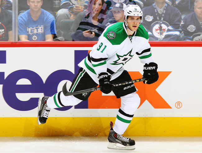 Hi-res-184177231-tyler-seguin-of-the-dallas-stars-follows-the-play-up_crop_650