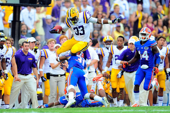 Hi-res-184237339-jeremy-hill-of-the-lsu-tigers-leaps-over-cody-riggs-of_display_image