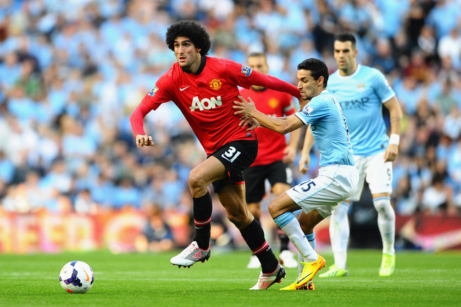 Hi-res-181548446-marouane-fellaini-of-manchester-united-holds-off-jesus_crop_650