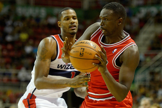 Hi-res-184235143-luol-deng-of-the-chicago-bulls-drives-on-trevor-ariza_crop_650