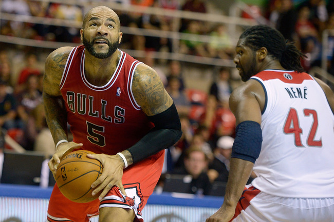 Hi-res-184235146-carlos-boozer-of-the-chicago-bulls-drives-on-nene-of_crop_650