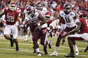Tra Carson runs the ball against Arkansas.