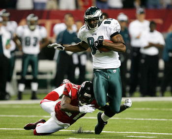Hi-res-55390197-terrell-owens-of-the-philadelphia-eagles-is-tackled-from_display_image
