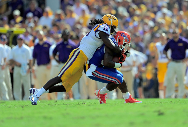 Hi-res-184231465-mack-brown-of-the-florida-gators-is-tackled-by-lamin_crop_650x440